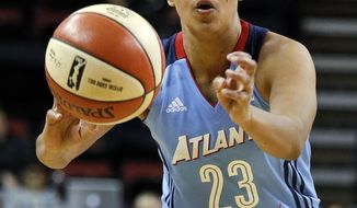 FILE- In this June 13, 2017, file photo, Atlanta Dream's Layshia Clarendon passes the ball against the Seattle Storm during the first half of a WNBA basketball game in Seattle. The University of California at Berkeley has fired Mohamed Muqtar, a longtime member of the athletic department, after an investigation found he violated the university's sexual violence and sexual harassment policy with former student-athletes, including women's basketball player Layshia Clarendon. Clarendon filed a lawsuit in January against the now-terminated Cal staffer, who initially had been placed on paid leave as Cal launched its investigation. (AP Photo/Elaine Thompson, File)