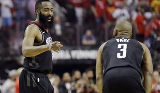 FILE - In this Monday, May 14, 2018, file photo, Houston Rockets guard James Harden, left, talks with teammate Chris Paul (3) during the first half of Game 1 of the NBA basketball Western Conference Finals against the Golden State Warriors in Houston. The Rockets are feeling good after routing the Warriors in Game 2 to tie the Western Conference finals at 1-1. But they know they have a huge task ahead of them as they head to Oracle Arena, a place the Warriors have won an NBA-record tying 15 straight playoff games, for games 3 and 4 .(AP Photo/David J. Phillip, File)