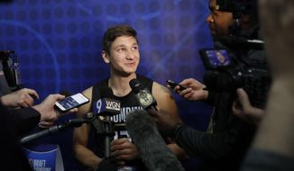 Grayson Allen, from Duke, listens to a question as he speaks with reporters at the NBA draft basketball combine Thursday, May 17, 2018, in Chicago. (AP Photo/Charles Rex Arbogast)
