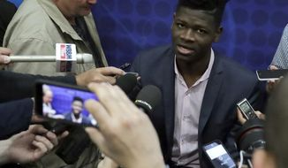 Mohamed Bamba, from Texas, speaks with the media at the NBA draft basketball combine Thursday, May 17, 2018, in Chicago. (AP Photo/Charles Rex Arbogast)