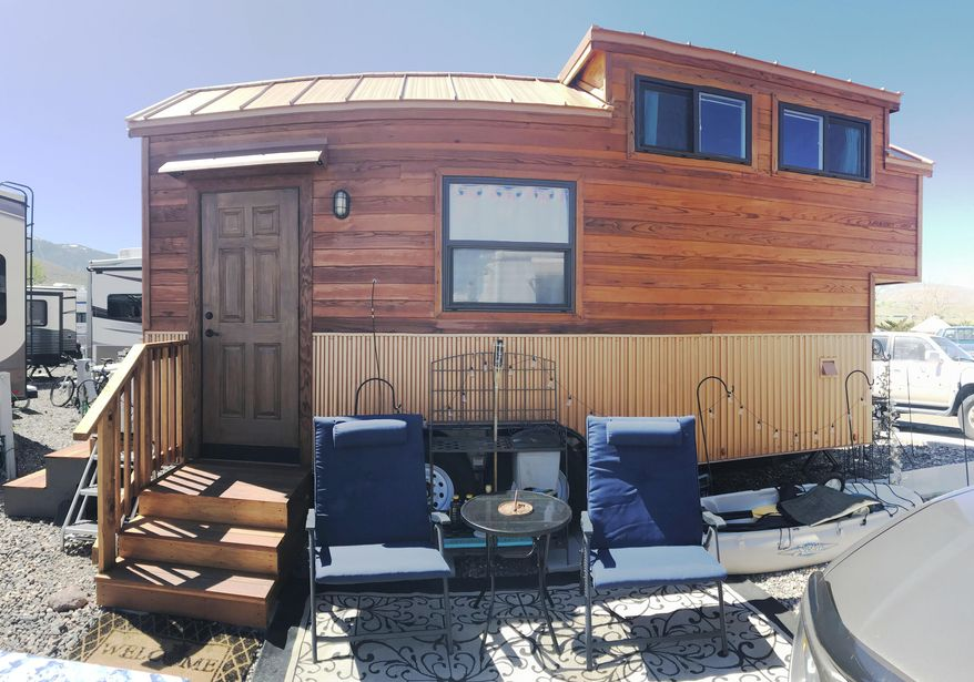 In a May 7, 2018 photo, Amy Killeen's tiny house is made like any other house, with real materials such as hardwood, corrugated metal, and cork flooring. It just happens to roll. (Kelsey Penrose/The Record Courier via AP)