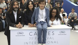 Composer Khaled Mouzanar, from left, director Nadine Labaki, actors Zain Al Rafeea, and Yordanos Shiferaw pose for photographers during a photo call for the film 'Capharnaum' at the 71st international film festival, Cannes, southern France, Friday, May 18, 2018. (Photo by Vianney Le Caer/Invision/AP)