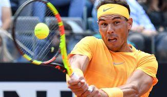 Spain's Rafael Nadal returns the ball to Italy's Fabio Fognini during a quarter final match at the Italian Open tennis tournament in Rome, Friday, May 18, 2018. (Ettore Ferrari/ANSA via AP)