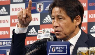 Japanese national soccer coach Akira Nishino answers reporter's question during a press conference on an upcoming friendly match against Ghana Friday, May 18, 2018, in Tokyo.  Keisuke Honda and Shinji Kagawa were named on Friday to Japan's squad for an international friendly on May 30 against Ghana in Yokohama.(AP Photo/Eugene Hoshiko)