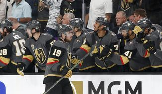 Vegas Golden Knights right wing Reilly Smith celebrates after scoring against the Winnipeg Jets during the third period of Game 4 of the NHL hockey Western Conference finals Friday, May 18, 2018, in Las Vegas. (AP Photo/John Locher)