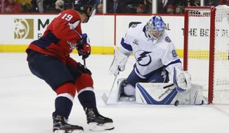 Tampa Bay Lightning goaltender Andrei Vasilevskiy (88) stops a shot by Washington Capitals center Nicklas Backstrom (19) during the second period of Game 4 of the NHL hockey Eastern Conference finals Thursday, May 17, 2018, in Washington. (AP Photo/Pablo Martinez Monsivais) ** FILE **