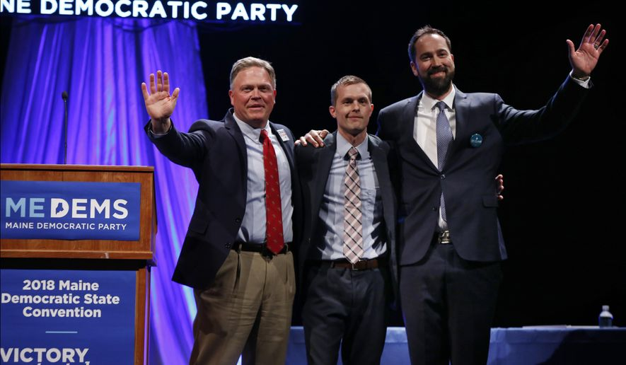 Craig Olson, from left, Jared Golden, and Lucas St. Clair, candidates for the 2nd District Congressional seat, acknowledge the crowd at the Democratic Convention, Friday, May 18, 2018, in Lewiston, Maine. (AP Photo/Robert F. Bukaty)