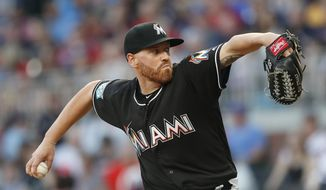 Miami Marlins starting pitcher Dan Straily works in the first inning of a baseball game against the Atlanta Braves, Friday, May 18, 2018, in Atlanta. (AP Photo/John Bazemore)