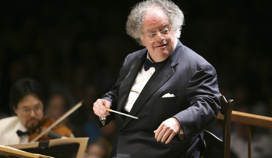 FILE - In this July 7, 2006 file photo, Boston Symphony Orchestra music director James Levine conducts the symphony on its opening night performance at Tanglewood in Lenox, Mass. The Metropolitan Opera says it found credible evidence that conductor James Levine engaged in sexually abusive or harassing conduct with seven people during his tenure with the company that included inappropriate touching and demands for sex acts over a 25-year period, Friday, May 18, 2018. (AP Photo/Michael Dwyer, File)