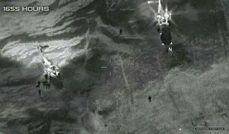 "This image from video released by the Department of Defense, shows two French helicopters evacuating the U.S. service members in Niger in October 2017, after an ambush by Islamic State-linked militants. On Friday, Nov. 1, 2019, the Pentagon announced a new U.S. drone base has become operational in Niger. Defense officials say it will allow for ""enhanced response"" to regional issues and better protection of the country's borders. (Department of Defense via AP) **FILE**"