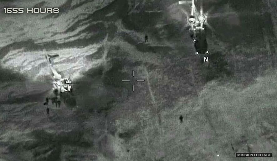"""This image from video released by the Department of Defense, shows two French helicopters evacuating the U.S. service members in Niger in October 2017, after an ambush by Islamic State-linked militants. On Friday, Nov. 1, 2019, the Pentagon announced a new U.S. drone base has become operational in Niger. Defense officials say it will allow for """"enhanced response"""" to regional issues and better protection of the country's borders. (Department of Defense via AP) **FILE**"""