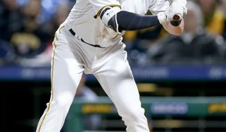 Pittsburgh Pirates' Colin Moran is hit by a pitch by San Diego Padres' Tyson Ross during the sixth inning of a baseball game Friday, May 18, 2018, in Pittsburgh. (AP Photo/Keith Srakocic)