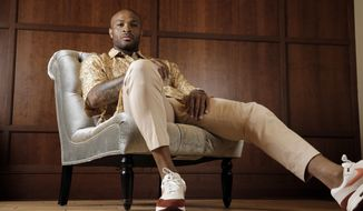Houston Rockets' P.J. Tucker poses in a shirt and pants from Dries Van Noten with Nike Air Max 1 shoes Tuesday, May 15, 2018, in Houston. Tucker's playing style and defensive grit helped the Houston Rockets to the Western Conference Finals. Off the court Tucker has spent years personally curating a wardrobe that has helped his style ascend to the upper echelons of fashion. (AP Photo/David J. Phillip)