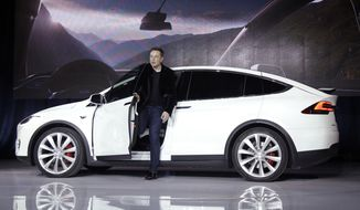 FILE - In this Sept. 29, 2015, file photo, Elon Musk, CEO of Tesla Motors Inc., introduces the Model X car at the company's headquarters in Fremont, Calif. For years, Tesla has boasted that its cars and SUVs are safer than other vehicles on the roads, and Musk doubled down on the claims in a series of tweets this week. (AP Photo/Marcio Jose Sanchez, File)
