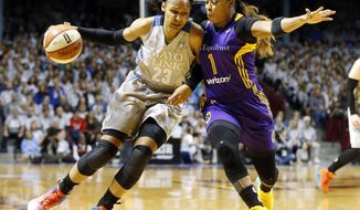 FILE - In this Oct. 4, 2017, file photo, Minnesota Lynx's Maya Moore, left, drives around Los Angeles Sparks' Odyssey Sims during the first half of Game 5 of the WNBA Finals in Minneapolis. The two teams have developed quite the rivalry over the past two seasons, having played for the title the last two years. (AP Photo/Jim Mone, File)