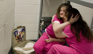 """ADVANCE FOR USE MONDAY, MAY 21, 2018 AND THEREAFTER-Inmate Crystal French, 38, left, is comforted by cellmate Krystle Sweat, 32, at the Campbell County Jail in Jacksboro, Tenn., Tuesday, March 30, 2018, after French was denied parole the previous day. She won't be eligible again for another year. """"I got to know the real me again instead of the addicted-to-drugs person. I'd like to be a productive citizen, not an OD statistic, end up dying on drugs,"""" said French, whose two sons are being raised by her ex-husband. """"I am a good person. I know I am. But I want to see that person again."""" (AP Photo/David Goldman)"""