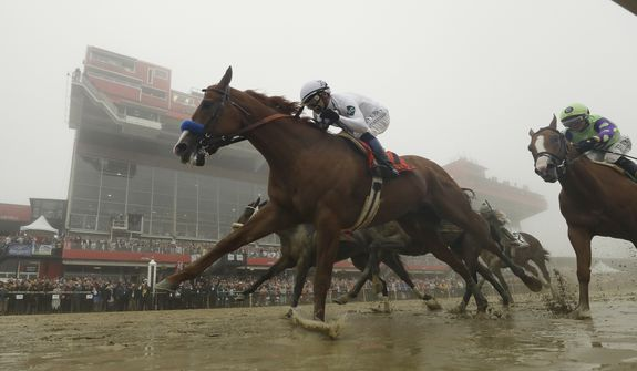 Justify with Mike Smith atop wins the the 143rd Preakness Stakes horse race at Pimlico race course, Saturday, May 19, 2018, in Baltimore. (AP Photo/Patrick Semansky) **FILE**