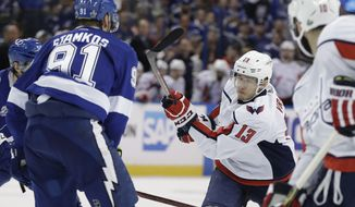 Washington Capitals left wing Jakub Vrana (13) follows through on a shot against the Tampa Bay Lightning during the third period of Game 5 of the NHL Eastern Conference finals hockey playoff series Saturday, May 19, 2018, in Tampa, Fla. The Lightning won the game 3-2. (AP Photo/Chris O'Meara)