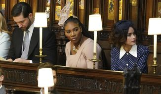 From left Alexis Ohanian, Serena Williams and Abigail Leigh Spencer are seated prior to the start of the wedding ceremony of Prince Harry and Meghan Markle at St. George's Chapel in Windsor Castle in Windsor, near London, England, Saturday, May 19, 2018. (Dominic Lipinski/pool photo via AP)
