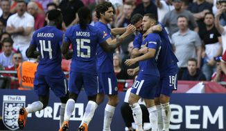 Chelsea's Eden Hazard, right, celebrates after scoring the opening goal during the English FA Cup final soccer match between Chelsea and Manchester United at Wembley stadium in London, Saturday, May 19, 2018. (AP Photo/Tim Ireland)