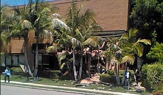 This image taken from cellphone video shows a building after a fatal explosion in Aliso Viejo, Calif., Tuesday, May 15, 2018. The cause of the blast is being investigated. Stephen Beal was charged Thursday, May 17, 2018, with possessing an unregistered destructive device and was awaiting a court appearance in federal court.   (Raul Hernandez via AP, File)