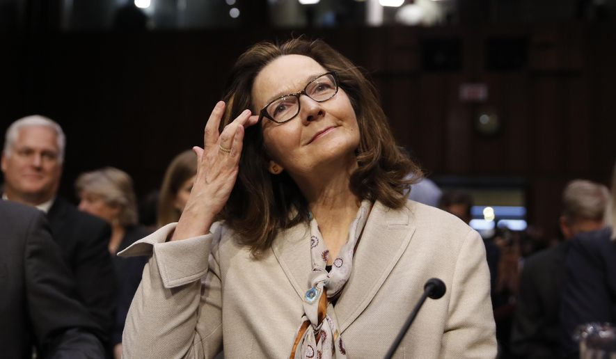 FILE - In this May 9, 2018, file photo, Gina Haspel arrives to her confirmation hearing at the Senate Intelligence Committee on Capitol Hill in Washington. Haspel's 33-year spy career began as the Cold War was thawing, but she was in the shadows countering Russian intelligence agencies that never stopped trying to penetrate the U.S. government. It's experience she can tap as she leads the agency amid rising tensions with Moscow. (AP Photo/Alex Brandon, File)