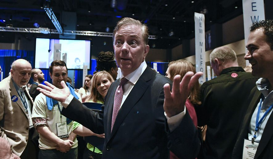 Candidate for governor Ned Lamont gestures to delegates during the State Democratic Convention, Saturday, May 19, 2018, in Hartford, Conn. Connecticut Democrats are gathering for a second consecutive day to finish endorsing their slate of candidates for the November elections, including governor. (AP Photo/Jessica Hill)
