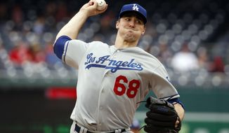 Los Angeles Dodgers starting pitcher Ross Stripling throws during the third inning of the first baseball game of a doubleheader against the Washington Nationals at Nationals Park, Saturday, May 19, 2018, in Washington. (AP Photo/Alex Brandon)