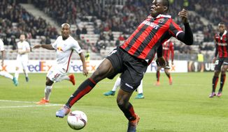 FILE - In this Thursday, Nov. 3, 2016 filer, Nice's forward Mario Balotelli controls the ball during the Europa League group I soccer match between OGC Nice and FC Salzburg, in Nice stadium, southeastern France. Mario Balotelli could make his first appearance for Italy in nearly four years after being named in a 30-man squad by new coach Roberto Mancini. Balotelli last played for Italy in the 2014 World Cup. He was called up by Antonio Conte in November of that year but was forced to withdraw from the squad with injury. (AP Photo/Claude Paris, File)