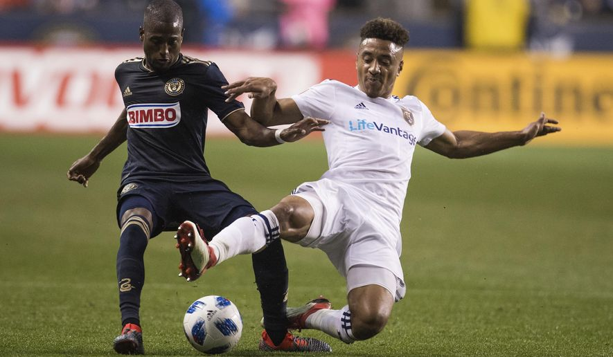 Real Salt Lake's Adam Henley, right, and Philadelphia Union's Fafa Picault compete for the ball during the first half of an MLS soccer match Saturday, May 19, 2018, in Chester, Pa. (AP Photo/Chris Szagola)