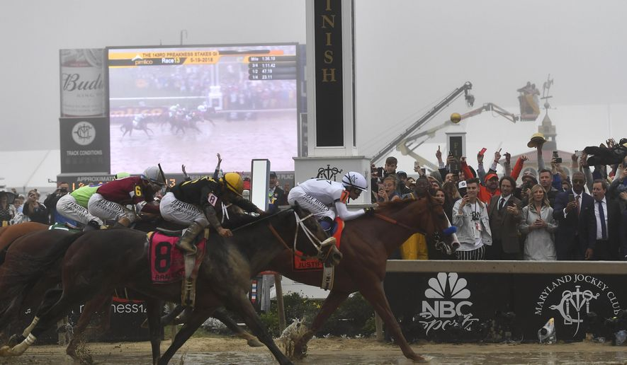 Justify with Mike Smith atop wins the 143rd Preakness Stakes horse race at Pimlico race track, Saturday, May 19, 2018, in Baltimore. Bravazo with Luis Saez aboard wins second with Tenfold with Ricardo Santana Jr. atop places. (AP Photo/Mike Stewart)
