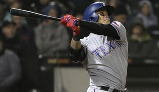 Texas Rangers' Shin-Soo Choo, of South Korea, hits a grand slam during the third inning of the team's baseball game against the Chicago White Sox, Friday, May 18, 2018, in Chicago. (AP Photo/Nam Y. Huh)