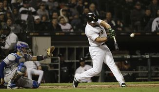 Chicago White Sox's Jose Abreu hits a solo home run during the seventh inning of a baseball game against the Texas Rangers, Saturday, May 19, 2018, in Chicago. (AP Photo/Nam Y. Huh)