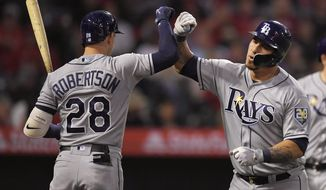 Tampa Bay Rays' Wilson Ramos, right, is congratulated by Daniel Robertson after hitting a two-run home run during the third inning of a baseball game against the Los Angeles Angels, Friday, May 18, 2018, in Anaheim, Calif. (AP Photo/Mark J. Terrill)