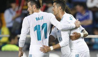 Real Madrid's Cristiano Ronaldo, and Gareth Bale celebrates after Ronaldo scored against Villarreal during a Spanish La Liga soccer match  at the Ceramica stadium in Villarreal, Spain, Saturday, May 19, 2018. (AP Photo/Alberto Saiz)