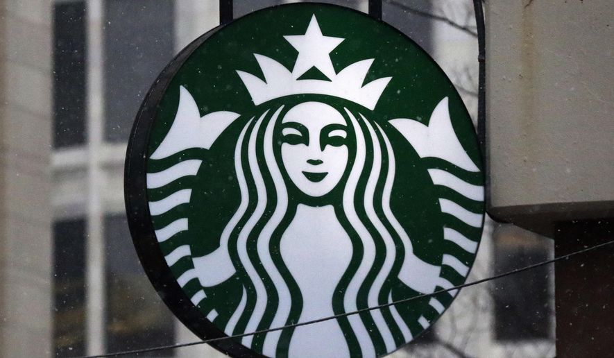 """FILE - This March 14, 2017, file photo show the Starbucks logo on a shop in downtown Pittsburgh. Starbucks is announcing a new policy that allows anyone to sit in its cafes or use its restrooms, even if they don't buy anything. Company executives have said its previous policies were loose and ambiguous, leaving decisions on whether people could sit in its stores or use the restroom up to store managers. Starbucks said Saturday, May 19, 2018 it has told workers to consider anyone who walks into its stores a customer, """"regardless of whether they make a purchase.""""  (AP Photo/Gene J. Puskar, File)"""