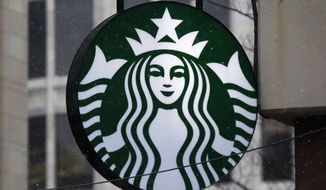 "FILE - This March 14, 2017, file photo show the Starbucks logo on a shop in downtown Pittsburgh. Starbucks is announcing a new policy that allows anyone to sit in its cafes or use its restrooms, even if they don't buy anything. Company executives have said its previous policies were loose and ambiguous, leaving decisions on whether people could sit in its stores or use the restroom up to store managers. Starbucks said Saturday, May 19, 2018 it has told workers to consider anyone who walks into its stores a customer, ""regardless of whether they make a purchase.""  (AP Photo/Gene J. Puskar, File)"