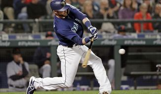 Seattle Mariners' Mitch Haniger doubles in a run against the Detroit Tigers during the seventh inning of a baseball game Friday, May 18, 2018, in Seattle. (AP Photo/Elaine Thompson)