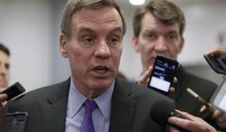 Senate Intelligence Committee Vice Chairman Sen. Mark Warner, D-Va. speaks to reporters on Capitol Hill in Washington, Wednesday, May 17, 2017. (AP Photo/J. Scott Applewhite) ** FILE **