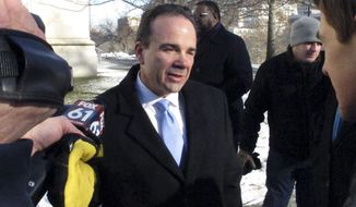 Bridgeport, Conn., Mayor Joe Ganim talks with reporters after filing papers to run for governor in Hartford, Conn., on Wednesday, Jan. 3, 2018. Ganim was elected Bridgeport mayor in 2015 after serving nearly seven years in prison for corruption committed during a previous term as mayor. (AP Photo/Dave Collins)