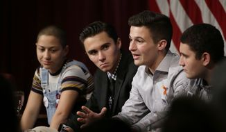 Marjory Stoneman Douglas High School students, and mass shooting survivors, from the left, Emma Gonzalez, David Hogg, Cameron Kasky, and Alex Wind, participate in a panel discussion about guns, Tuesday, March 20, 2018, at Harvard Kennedy School's Institute of Politics, in Cambridge, Mass. The Feb. 14, 2018 attack in Florida killed 17 people, 14 of them students. The students have become vocal advocates for stricter gun laws. (AP Photo/Steven Senne)