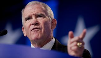 Retired Marine Lt. Col. Oliver North speaks at the 2014 Values Voter Summit in Washington, Friday, Sept. 26, 2014.  Prospective Republican presidential candidates are promoting religious liberty at home and abroad at a gathering of evangelical conservatives, rebuking an unpopular President Barack Obama while skirting divisive social issues that have tripped up the GOP.  (AP Photo/Manuel Balce Ceneta)