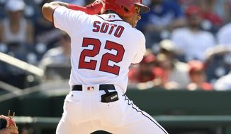 Washington Nationals' Juan Soto bats during the eighth inning of a baseball game against the Los Angeles Dodgers, Sunday, May 20, 2018, in Washington. (AP Photo/Nick Wass)