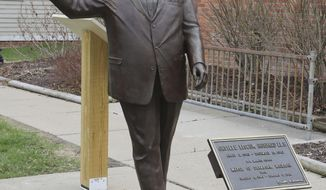 In a photo from, Friday, April 27, 2018, a statue of former Mayor Orville Hubbard, who spent decades trying to keep the city all white, is displayed in Dearborn, Mich. The statue was socked away for more than a year after leaders decided it didn't belong outside a new City Hall. Vestiges of racism and intolerance are slowly being moved and removed in Michigan and other northern states as calls continue in the South to take down such monuments. (AP Photo/Carlos Osorio)