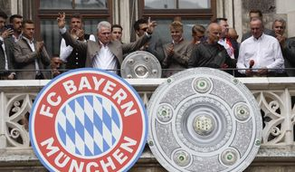 Bayern coach Jupp Heynckes celebrates on the balcony of the town hall at Marienplatz square the 28th Bundesliga title at the German first division Bundesliga in Munich, Germany, Sunday, May 20, 2018. (AP Photo/Matthias Schrader)