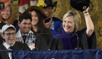 Former Secretary of State and former Democratic Presidential candidate Hillary Clinton holds up a Russian fur hat, an ushanka, with a Soviet era hammer and sickle emblem, to the Yale College class of 2018 during her Class Day address at Yale University in New Haven, Conn., Sunday, May 20, 2018. As a tradition, Yale students and faculty wear humorous and playful hats during a Senior Class Day ceremony. (Peter Hvizdak/New Haven Register via AP) ** FILE **