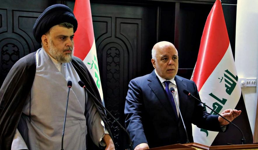 "In this photo provided by the Iraqi government, Iraqi Prime Minister Haider al-Abadi, right, and Shiite cleric Muqtada al-Sadr hold a press conference in the heavily fortified Green Zone in Baghdad, Iraq, early Sunday, May 20, 2018. Shiite cleric Muqtada al-Sadr, whose coalition won the largest number of seats in Iraq's parliamentary elections, says the next government will be ""inclusive."" The May 12 vote did not produce a single bloc with a majority, raising the prospect of weeks or even months of negotiations to agree on a government. (Iraqi Government via AP) **FILE**"