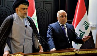 "In this photo provided by the Iraqi government, Iraqi Prime Minister Haider al-Abadi, right, and Shiite cleric Muqtada al-Sadr hold a press conference in the heavily fortified Green Zone in Baghdad, Iraq, early Sunday, May 20, 2018. Shiite cleric Muqtada al-Sadr, whose coalition won the largest number of seats in Iraq's parliamentary elections, says the next government will be ""inclusive."" The May 12 vote did not produce a single bloc with a majority, raising the prospect of weeks or even months of negotiations to agree on a government. (Iraqi Government via AP)"