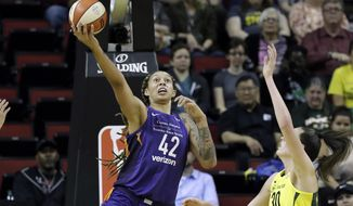 Phoenix Mercury's Brittney Griner (42) get a shot past Seattle Storm's Breanna Stewart in the first half of a WNBA basketball game Sunday, May 20, 2018, in Seattle. (AP Photo/Elaine Thompson)