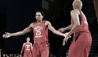 Monique Currie (No. 25) celebrates a play with teammate Tianna Hawkins during a Washington Mystics game. (Photo courtesy of Twitter / @WashMystics) ** FILE **